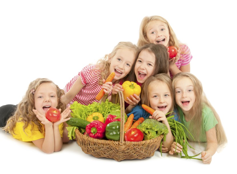 Happy children with vegetables