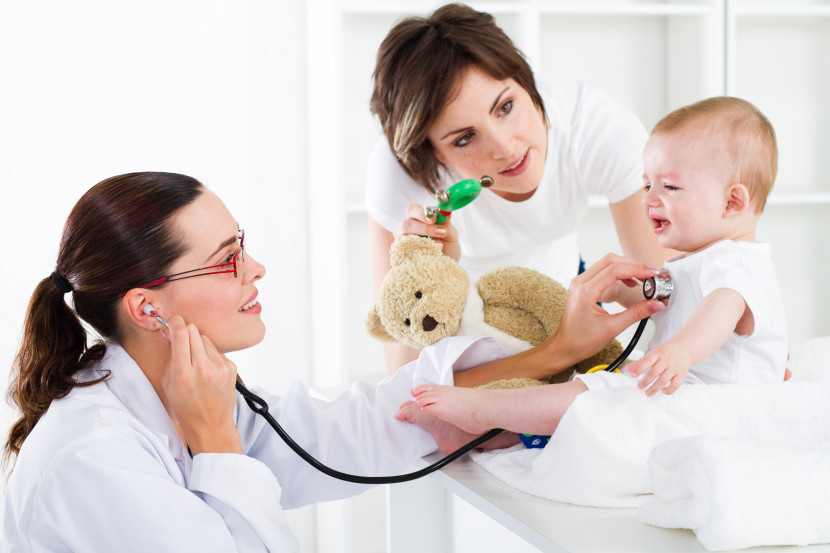 paediatrician checking baby