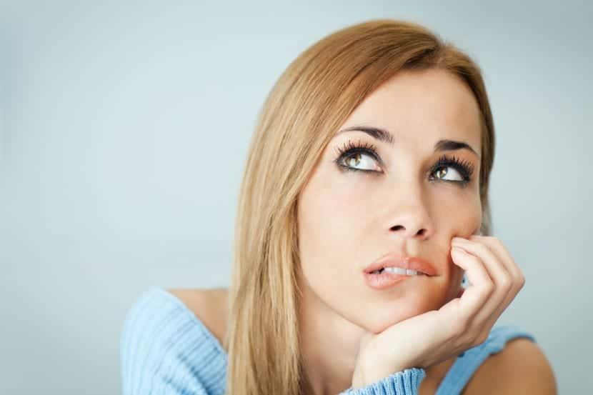 pensive woman biting lips
