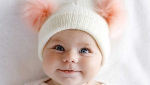 dulce bebe nena con pompones